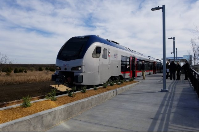 The new TEX Rail train goes into service Thursday from downtown Fort Worth to Dallas-Fort Worth International Airport. The train opened five days later than planned because of the partial government shutdown. Photo by Nicholas Sakelaris/UPI