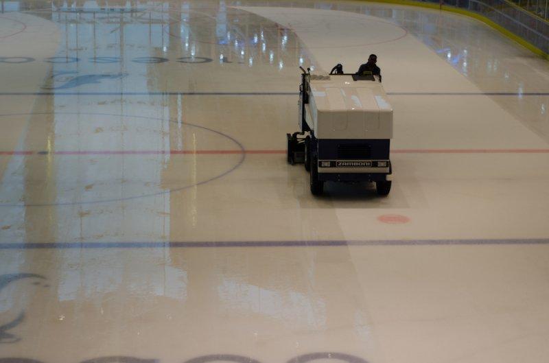 A Zamboni ice resurfacer polishes the ice on a hockey rink. Photo by Ahmad Rashdan/Shutterstock.com