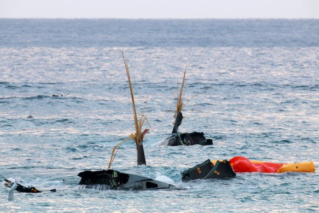 Debris of an Osprey aircraft can be seen after it crash landed in the sea on December 13 off the coast of Nago, Okinawa Island, southwestern Japan. According to reports, the crew members were reportedly being treated at a U.S. Naval Hospital with unspecified injuries. The Japanese government has since asked U.S. forces to ground all Osprey tilt-rotor military aircrafts Photo by Hitoshi MAeshiro/European Pressphoto Agency