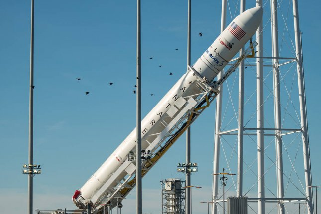 The Antares rocket with a Cygnus spacecraft on board is raised into the vertical position in 2016 at NASA's Wallops Flight Facility in Virginia. Photo courtesy of NASA