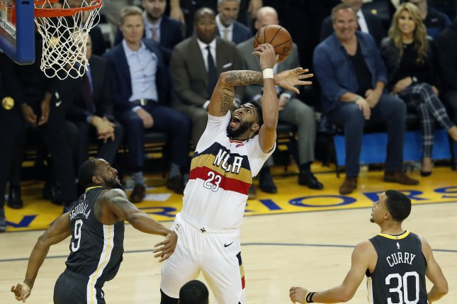 ca3726b711d New Orleans Pelicans forward Anthony Davis (C) draws a foul from Golden  State Warriors guard Andre Iguodala (L) as guard Stephen Curry (R) looks on  during ...