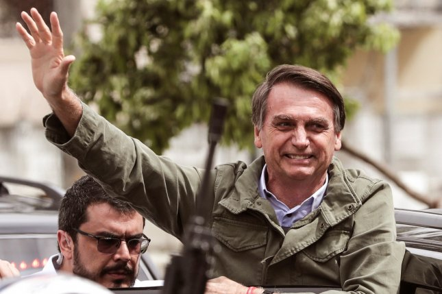 Brazilian President Jair Bolsonaro, (R) shown here in October 2018, will not face criminal charges related to a comment he reportedly made in 2014. File Photo EPA-EFE/Antonio Lacerda