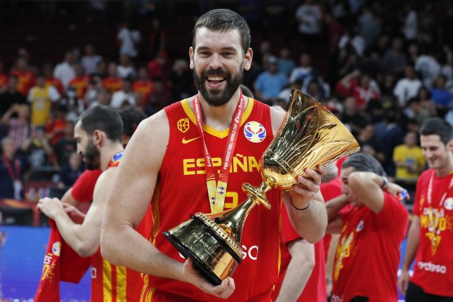 Marc Gasol of Spain celebrates with the World Cup trophy following their win against Argentina in the 2019 FIBA Basketball World Cup final on Sunday in Beijing, China. Photo by Roman Pilipey/EPA-EFE