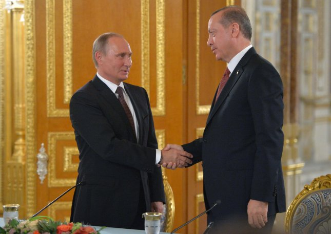 Russian President Vladimir Putin (L) shakes hands with Turkey's President Recep Tayyip Erdogan during a joint press conference following their talks on the sidelines of the 23rd World Energy Congress, in Istanbul, Turkey on October 10. File Photo by Alexei Druzhinin/Sputnik/Kremlin Pool
