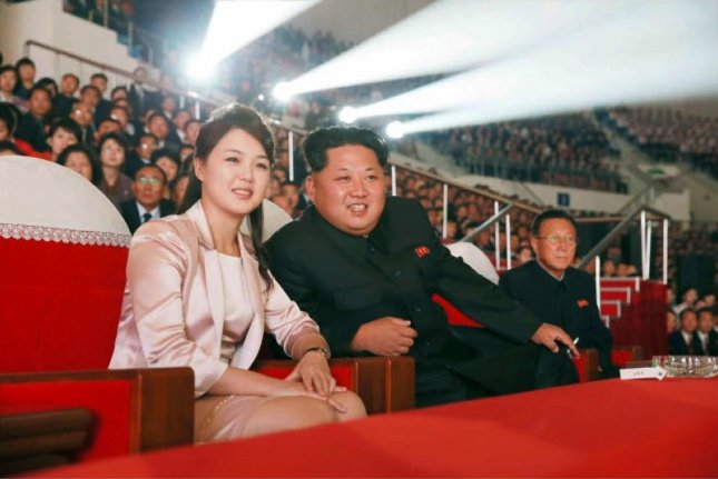 North Korean leader Kim Jong Un and his wife, Ri Sol Ju, watch a joint performance given by the State Merited Chorus and the Moranbong Band in a undated photo released by Rodong Sinmun newspaper, the state-run North Korean newspaper of the ruling Workers Party, in 2015. File Photo courtesy of Rodong Sinmun