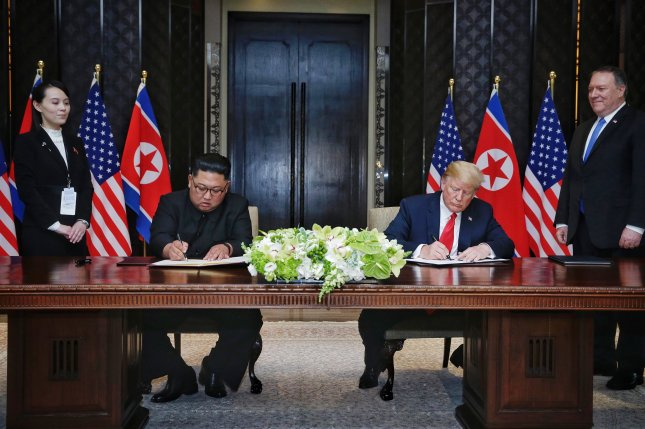 U.S. President Donald Trump (R) and Kim Jong Un (L) sign the U.S.-North Korea joint statement at their first summit in Singapore on June 12, 2018. On Tuesday, the United States called on Pyongyang to take steps toward denuclearization. File Photo by Kevin Lim/The Straits Times/EPA-EFE