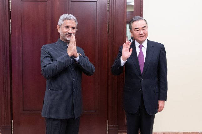 India's top diplomat Subrahmanyam Jaishankar (L) and Chinese Foreign Minister Wang Yi exchanged a 75-minute phone call Friday to address a bilateral relationship marked by recent disputes. File Photo by Bai Xueqi/Xinhua/EPA-EFE