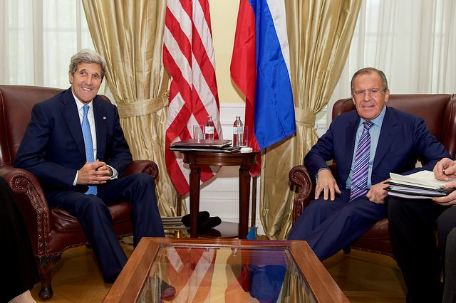 U.S. Secretary of State John Kerry, left, shares a laugh with Russian Foreign Minister Sergey Lavrov on June 30, in Vienna, Austria. On Tuesday, Russian and U.S. officials agreed to resume talks about how to avoid conflict in the skies over Syria, where both nations are conducting airstrikes independent of one another. Photo courtesy of the U.S. State Department
