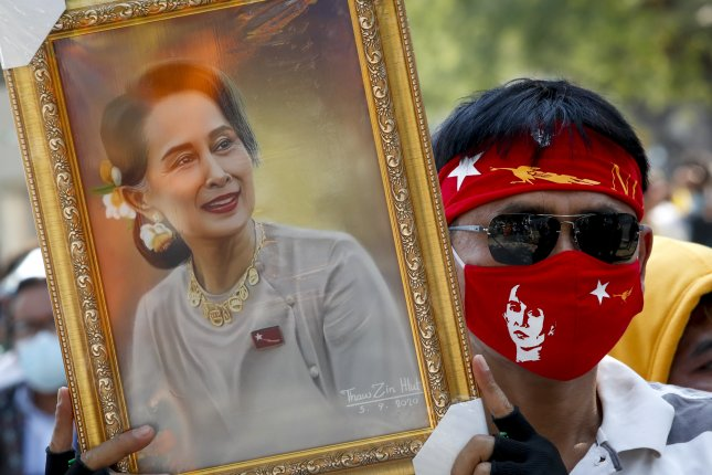 A Myanmar demonstrator wearing a protective face mask holds a photo of Myanmar democracy icon Aung San Suu Kyi during a protest against the Myanmar military coup, outside the United Nations building in Bangkok, Thailand, on Tuesday. Photo by Diego Azubel/EPA-EFE