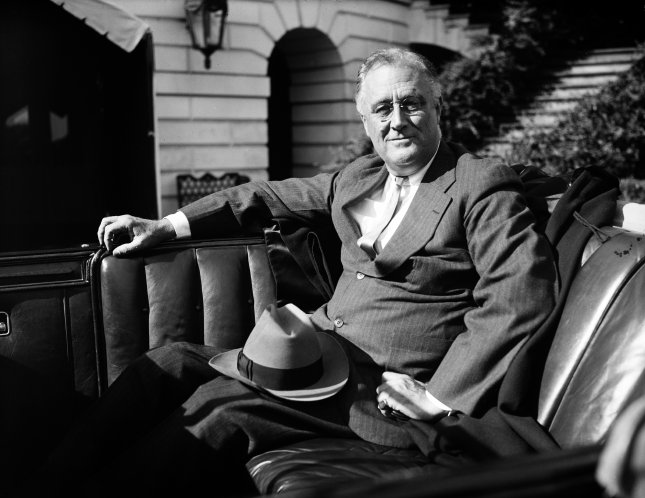 President Franklin Roosevelt waiting in his car outside the White House ca. 1936. File Photo by Library of Congress/UPI