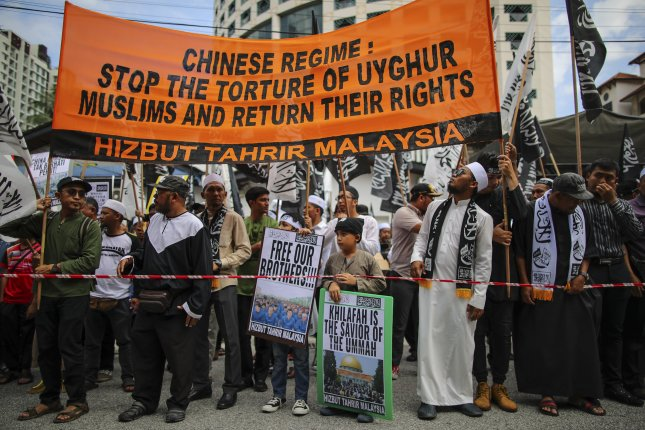 People protest China's alleged abuse of the Muslim Uighur community in Xinjiang province, near the Chinese Embassy in Kuala Lumpur, Malaysia, on December 27. File Photo by Fazry Ismail/EPA-EFE