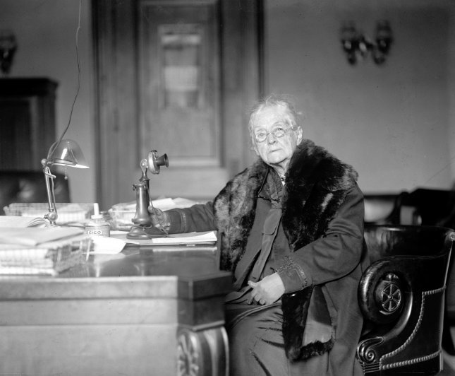 United States Senator Rebecca Felton of Georgia is pictured at her desk in Washington, DC. On October 3, 1922, Mrs. Felton was chosen to fill the seat left vacant following the premature death of Senator Thomas E. Watson, becoming the first woman to serve in the United States Senate. She was sworn in on November 21, 1922, and served just 24 hours. Photo by National Photo Company/Library of Congress/UPI