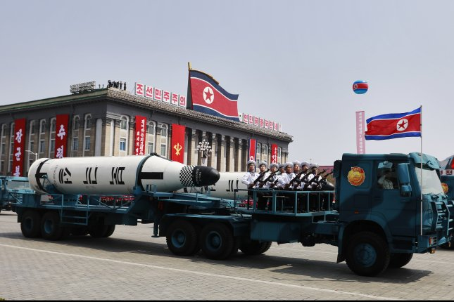 North Korean military vehicles carrying missiles drive past during a parade for the 'Day of the Sun' festival on Kim Il Sung Square in Pyongyang, North Korea, on April 15. Photo by How Hwee Young/EPA
