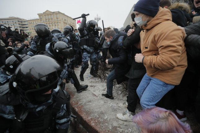 Russian special police units officers clash Saturday with protesters during an unauthorized protest in support of Russian opposition leader and blogger Alexei Navalny in Moscow. Photo by Maxim Shipenkov/EPA-EFE