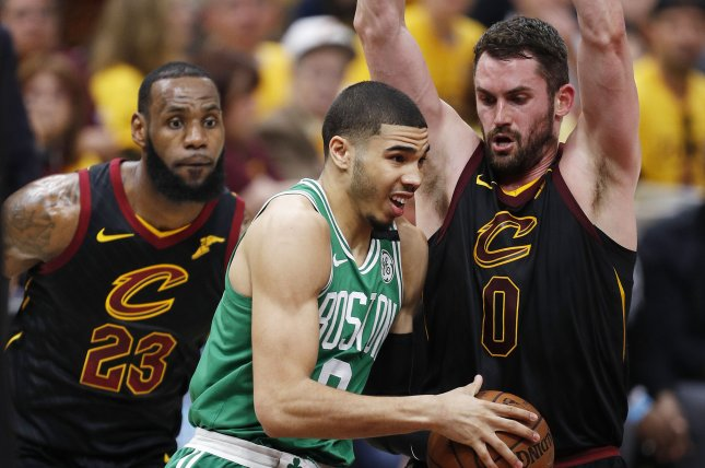 Kevin Love (R) of the Cleveland Cavaliers defends against Jayson Tatum (C) of the Boston Celtics as Cavaliers LeBron James (L) looks on. Photo by David Maxwell/EPA-EFE/Shutterstock