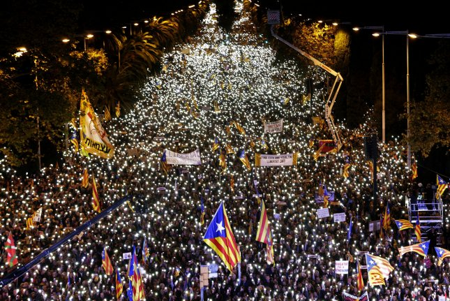 Demonstrators rally to demand the release of former Catalonian regional ministers and social leaders imprisoned in Barcelona, Spain, on Saturday. Photo by Alberto Estevez/EPA-EFE