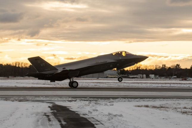 A pilot assigned to the 134th Fighter Squadron, Vermont Air National Guard, lands a F-35 Lightning II aircraft at the Vermont Air National Guard Base in Vermont Dec. 5. Lockheed Martin has received $2.35 billion in new contracts for the F-35 program. Photo by Julie M. Shea/U.S. Air National Guard
