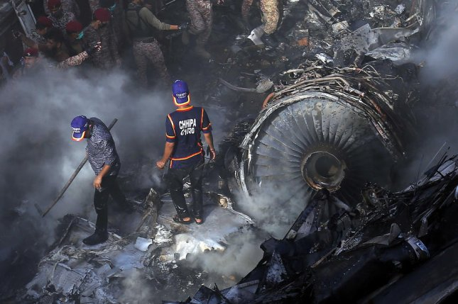 Rescue workers search for survivors in the debris from a passenger plane that crashed Friday in residential colony in Karachi, Pakistan. Photo by Shahzaib Akber/EPA-EFE