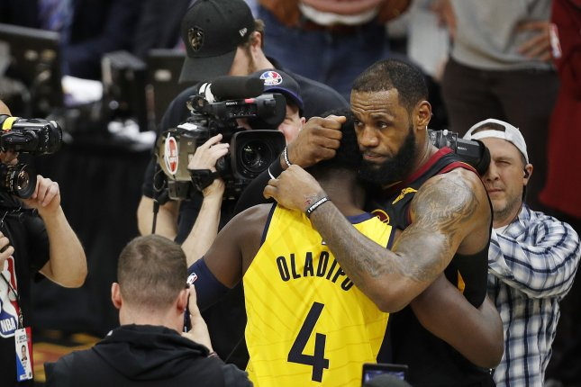 LeBron James (R) of the Cleveland Cavaliers and Victor Oladipo (L) of the Indiana Pacers embrace after the Cavaliers defeated the Pacers in Game 7 of the Eastern Conference first round Playoffs Sunday at Quicken Loans Arena in Cleveland, Ohio. Photo by David Maxwell/EPA-EFE/Shutterstock