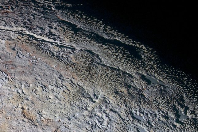 NASA's New Horizons spacecraft captured an extended color image of Pluto during a flyby in July 2015. On New Year's Day 2019, the spacecraft is expected to be the first human vessel to do a flyby of an object in the Kuiper Belt. Photo by NASA/JHUAPL/SWRI