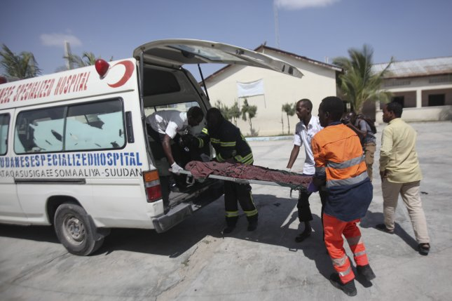 Ambulance workers treat a victim at the scene of a suicide attack in Mogadishu, Somalia, on December 22, 2018. Militant group al Shabab was suspected in the attack, as well as another on Sunday that killed a former regional governor. File Photo by Yusuf Warsame/EPA-EFE