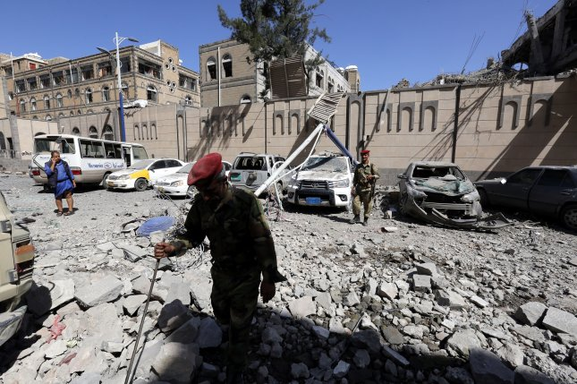 Yemeni soldiers inspect a site damaged by airstrikes that hit the presidential palace in Sana'a, Yemen in May. Photo by Yahya Arhab/EPA-EFE