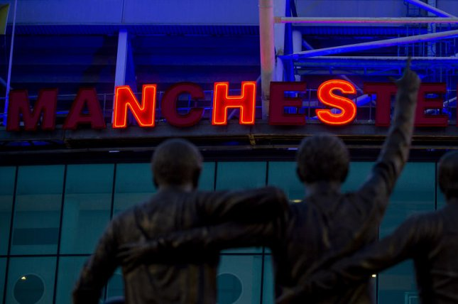 Manchester United Stadium was lit blue on Thursday in recognition of National Heath Service staffers working during the coronavirus pandemic in Britain. Photo by Peter Powell/EPA-EFE