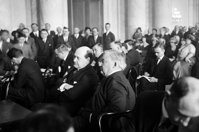 Harry F. Sinclair, multimillionaire oil magnate (L) and his counsel Martin W. Littleton during hearing on the Teapot Dome scandal in 1924. File Photo by Library of Congress/UPI