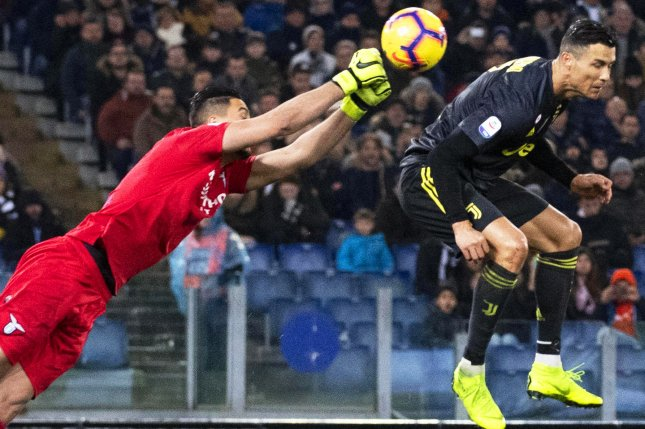 Juventus' Cristiano Ronaldo (R) in action against Lazio's goalkeeper Thomas Strakosha (L) during the Italian Serie A soccer match between SS Lazio and Juventus FC on Sunday in Rome. Photo by Claudio Peri/EPA-EFE