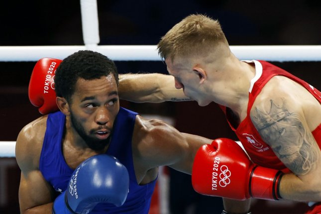 Duke Ragan of the United States (L) won silver in the men's feather (52-57kg) final bout on Thursday after losing to Russian Albert Batyrgazievby split decision. Photo by Rungroj Yongrit/EPA-EFE