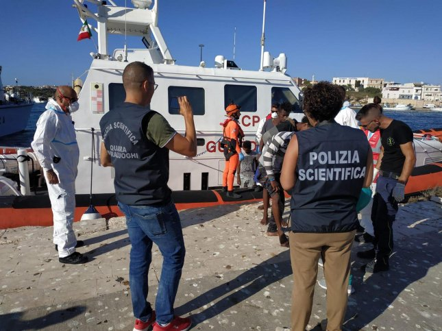 Some of the 27 unaccompanied minors disembark a ship of the Italian coast guard in Lampedusa, Sicily, southern Italy, on Saturday. Photo by Concetta Rizzo/EPA-EFE