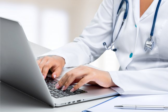 Nearly half of Americans have used technology to communicate with their doctors, but only 21 percent said they had a conversation with their doctor about how to correspond digitally, a new survey found. File photo by www.BillionPhotos.com/Shutterstock