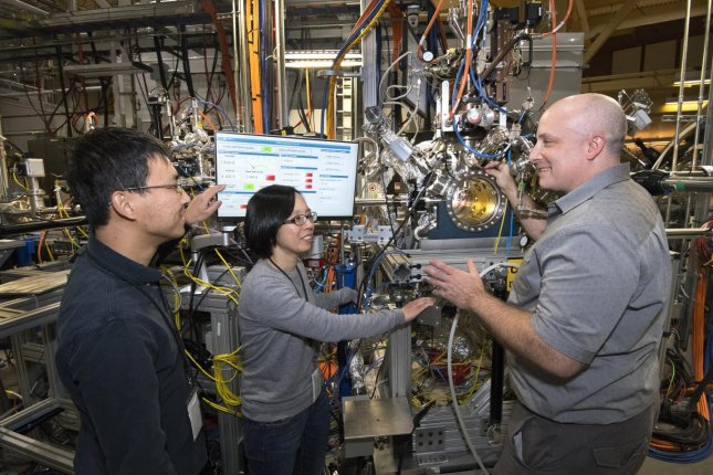Brookhaven Lab scientists Mingyuan Ge, Iradwikanari Waluyo and Adrian Hunt, pictured left to right, at the IOS beamline, where they studied the growth pathway of an efficient catalyst for hydrogen fuel cells. Photo courtesy of Brookhaven National Laboratory
