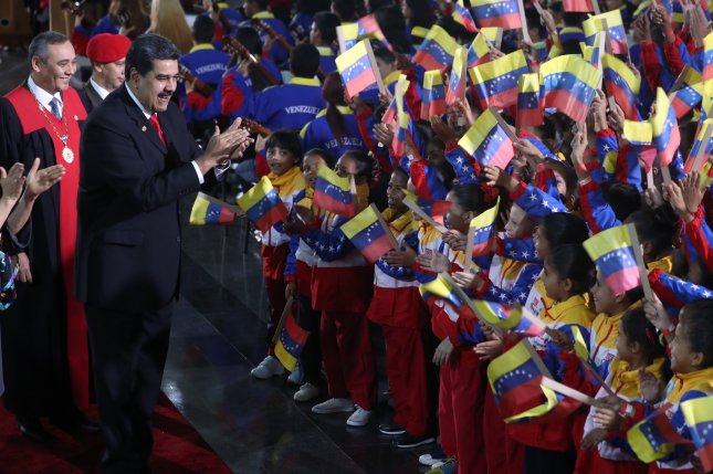 Venezuelan President Nicolas Maduro greets a group of children upon his arrival at his inauguration ceremony in Caracas Thursday January 10. Photo by Miguel Gutierrez/EPA-EFE