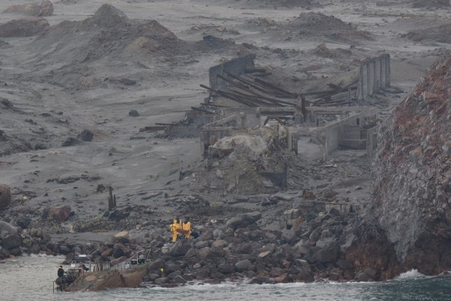 This photo shows Royal New Zealand Navy search personnel during a recovery operation on White Island (Whakaari), New Zealand on Friday. Police say a total of 15 people have died and more than 24 were injured in an eruption on White Island on Monday. Photo courtesy of the Royal New Zealand Navy