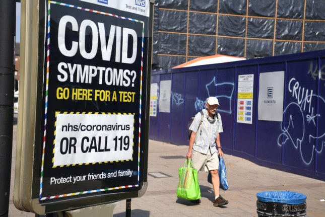 A sign is seen promoting a coronavirus help line (119) in London, Britain, on September 15. Photo by Facundo Arrizabalaga/ EPA-EFE