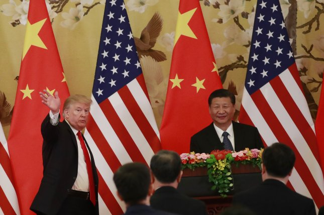 China is urging the United States to not see trade as a zero sum game following reports of tougher restrictions against Chinese investments and imports. File Photo by How Hwee Young/EPA-EFE