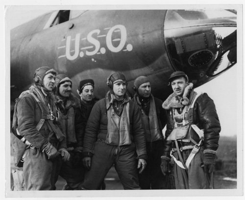Walter Cronkite, correspondent with United Press (UP), poses with the crew of a U.S.O. airplane during World War II. Photo courtesy Cronkite Papers/University of Texas at Austin