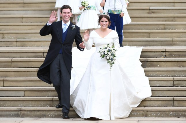 Britain's Princess Eugenie (R) and her husband Jack Brooksbank exit St George's Chapel in Windsor Castle after their royal wedding ceremony, in Windsor, Britain, on Friday. Photo by Neil Hall/ EPA-EFE