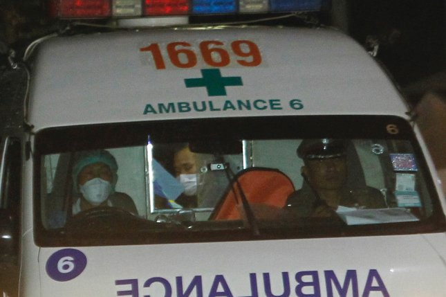 An ambulance arrives at a hospital Sunday with a member of the youth soccer team rescued from the Tham Luang cave in Chiang Rai province, Thailand. Photo by Pongmanat Tasiri/EPA