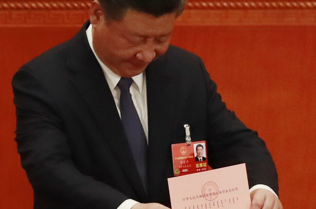Chinese President Xi Jinping casts his vote Sunday during the National People's Congress at the Great Hall of the People in Beijing. Among the Constitution changes presidential term limits were removed. Photo by How Hwee Young/EPA