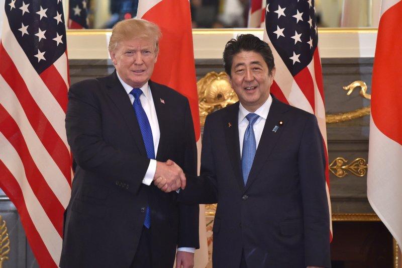 U.S. President Donald Trump (L) shakes hands with Japanese Prime Minister Shinzo Abe before a summit meeting at Akasaka Palace in Tokyo, Japan, on Monday. Pool Photo by Kazuhiro Nogi/EPA-EFE