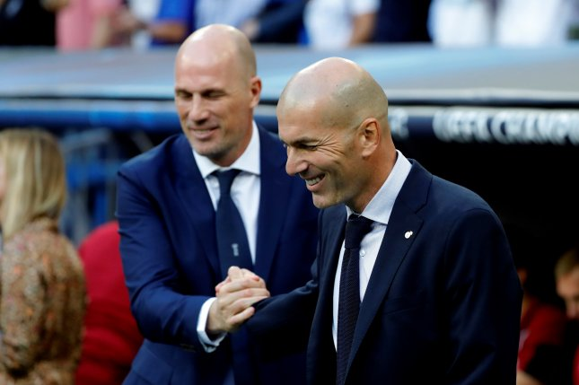 Real Madrid manager Zinedine Zidane (R) led the La Liga squad to three consecutive Champions League titles before briefly resigning in 2018. He returned to the Spanish soccer club in March. Photo by JuanJo Martin/EPA-EFE