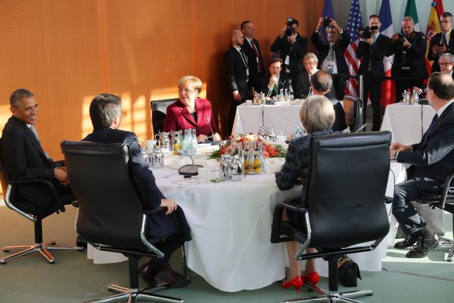 German Chancellor Angela Merkel (C) speaks with President Barack Obama (L), French President Francois Hollande (2-R), Spain's Prime Minister Mariano Rajoy (R), British Prime Minister Theresa May (C-R) and Italian Prime Minister Matteo Renzi (C-L), during a talk of the heads of government of Germany, France, Italy, Great Britain and Spain at the chancellery in Berlin on Friday. Obama is on a three-day visit to the German captial. Photo by Kay Nietfeld/European Press Agency