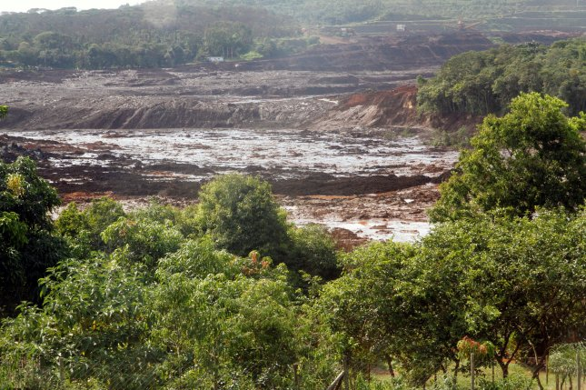 A general view on damage caused by the breakage of a dam containing mineral waste from Vale, the world's largest iron producer, in Brumadinho, Brazil, on January 25. Sixteen executives from Vale and German safety firm TUV SUD were charged with murder in connection with the collapse. File Photo by Paulo Fonseca/EPA-EFE