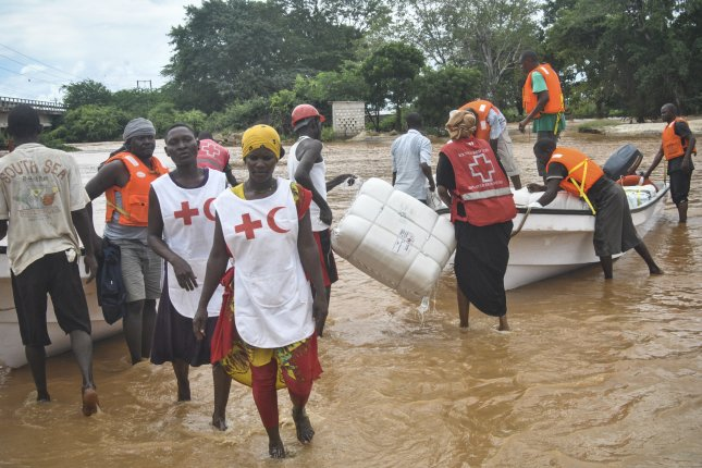 A group of aid workers from the Kenya Red Cross transport emergency relief supplies to displaced flood victims near the Tana River in Idsowe, Tana River County in Kenya May 3, 2018. The United Nations said 79 million were displaced by war and other emergencies in 2019. Photo by STR/EPA-EFE