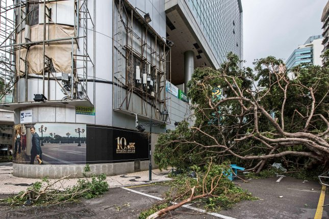 Destruction is seen in Macau on Wednesday after Typhoon Hato passed through. The storm killed at least 12 people and cut power to thousands. Photo by Antonio Mil-Homens/EPA