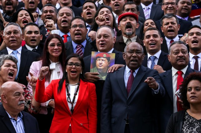 Representatives elected to the National Constituent Assembly pose for the official photo, in Caracas on Friday. Former Foreign Minister Delcy Rodriguez (in red) was named president of the body. Photo by Cristian Hernandez/EPA