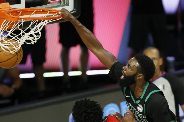 Boston Celtics forward Jaylen Brown (R) had 27 points and six rebounds in 37 minutes in a playoff win over the Toronto Raptors Monday in Orlando, Fla. Photo by Erik S. Lesser/EPA-EFE