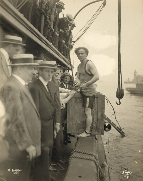 Harry Houdini stepping into a crate that will be lowered into New York Harbor as part of an escape stunt on July 7, 1912. Houdini died on October 31, 1926. File Photo by Library of Congress/UPI